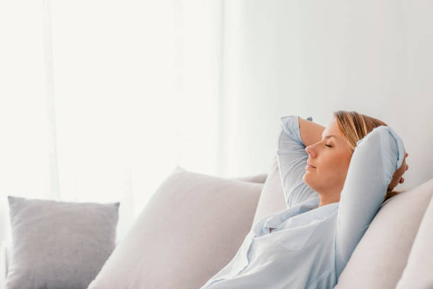 Woman sleeping on vacations in an apartment stock photo