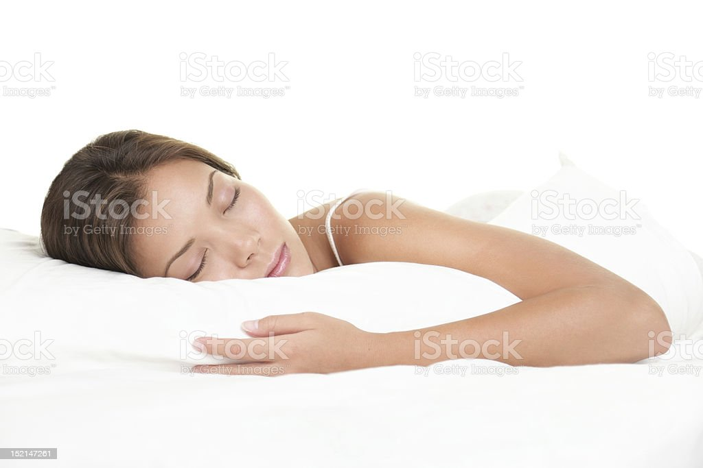 Woman sleeping on white background stock photo