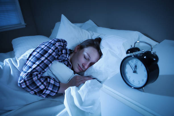 Frau Schlafen Sie friedlich und erholsamen Schlaf im Bett mit Sweet Dream – Foto