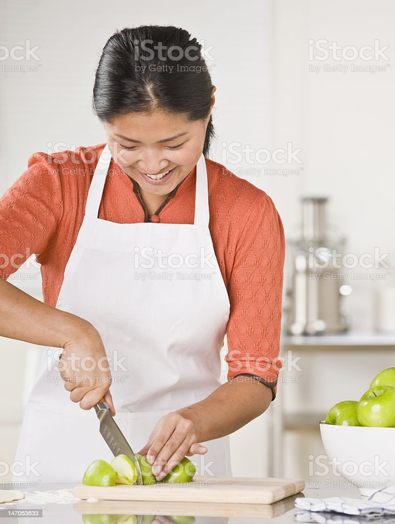Woman Slicing Apples royalty-free stock photo