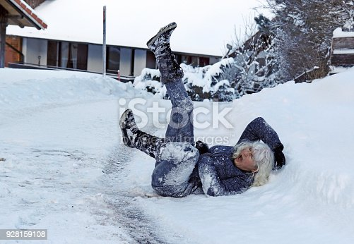 istock A woman slipped on the winter road, fell down and hurt herself 928159108