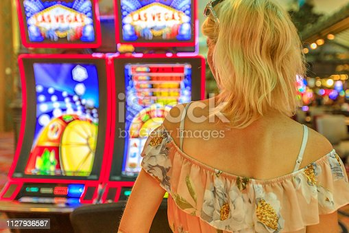 istock Woman slot machines 1127936587