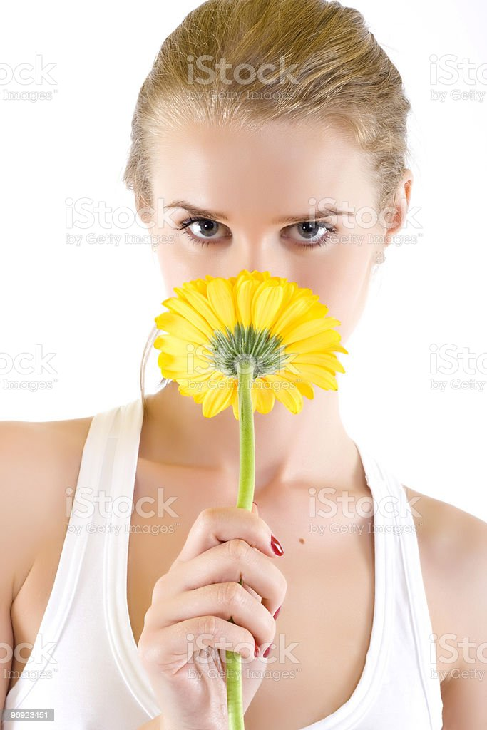 woman smelling a yellow flower royalty-free stock photo