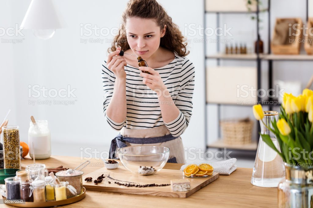 Woman smelling essential oil stock photo