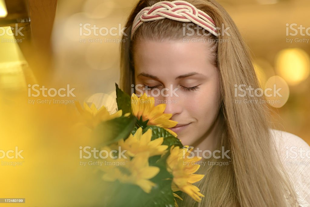 woman smelling flower royalty-free stock photo