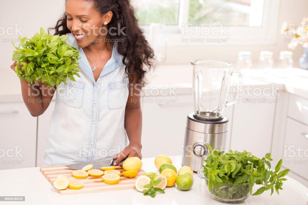 Woman smelling fresh spearmint. stock photo