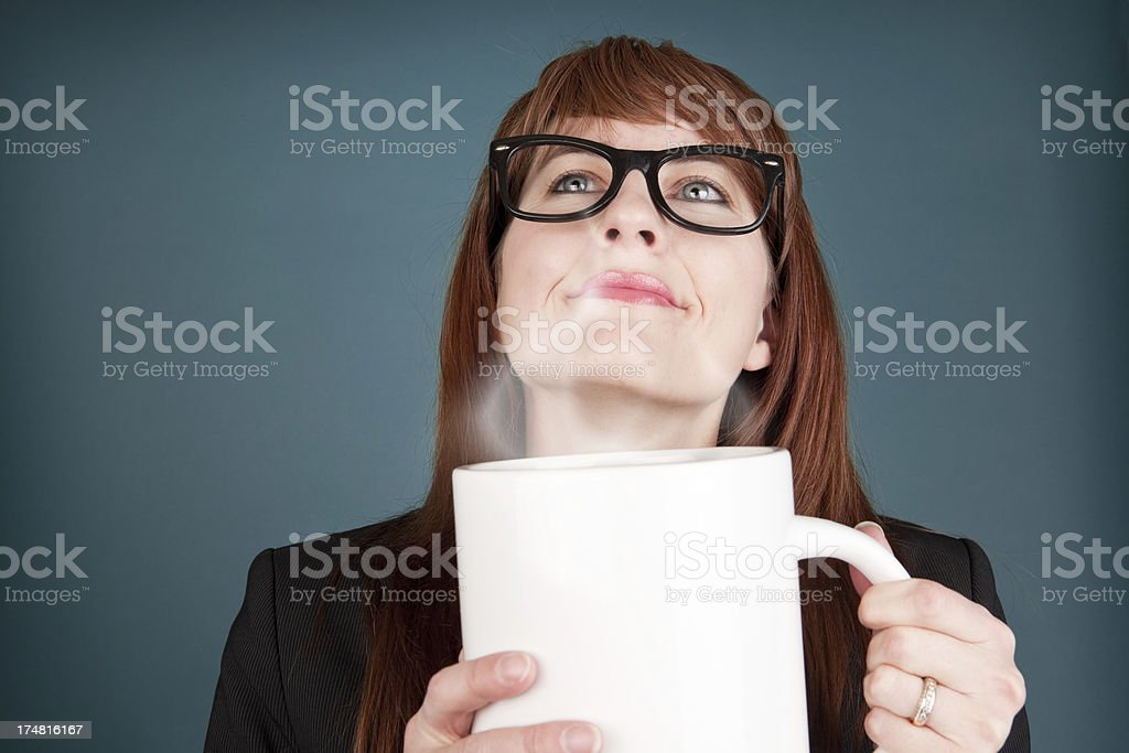 Woman Smelling Giant Cup of Steaming Coffee royalty-free stock photo