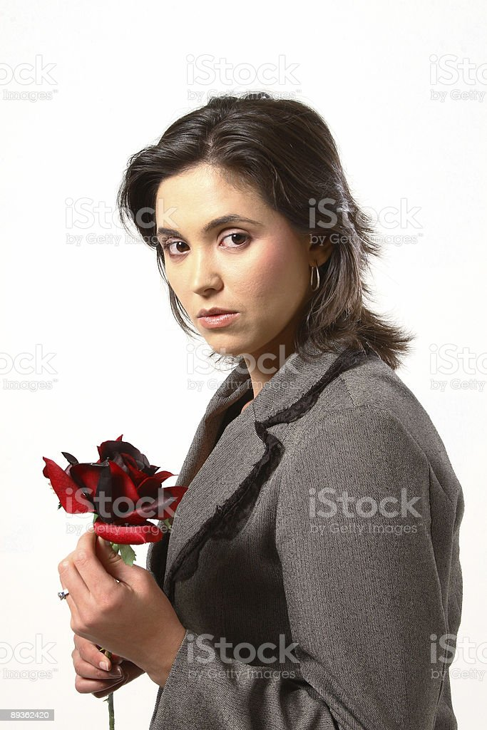 Woman smelling rose royaltyfri bildbanksbilder