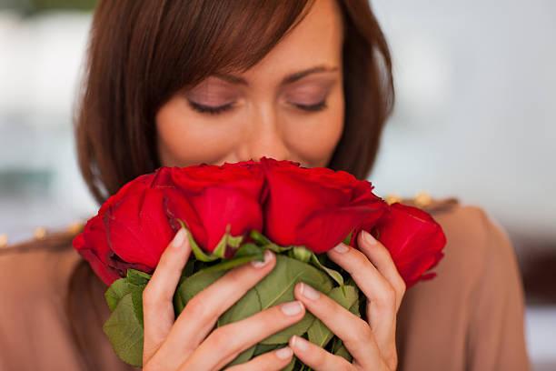 Woman smelling roses picture id171086228?b=1&k=6&m=171086228&s=612x612&w=0&h=w8qgvyd fz9nyu0d5luqbwns2lo2ktqnmitg gkausu=
