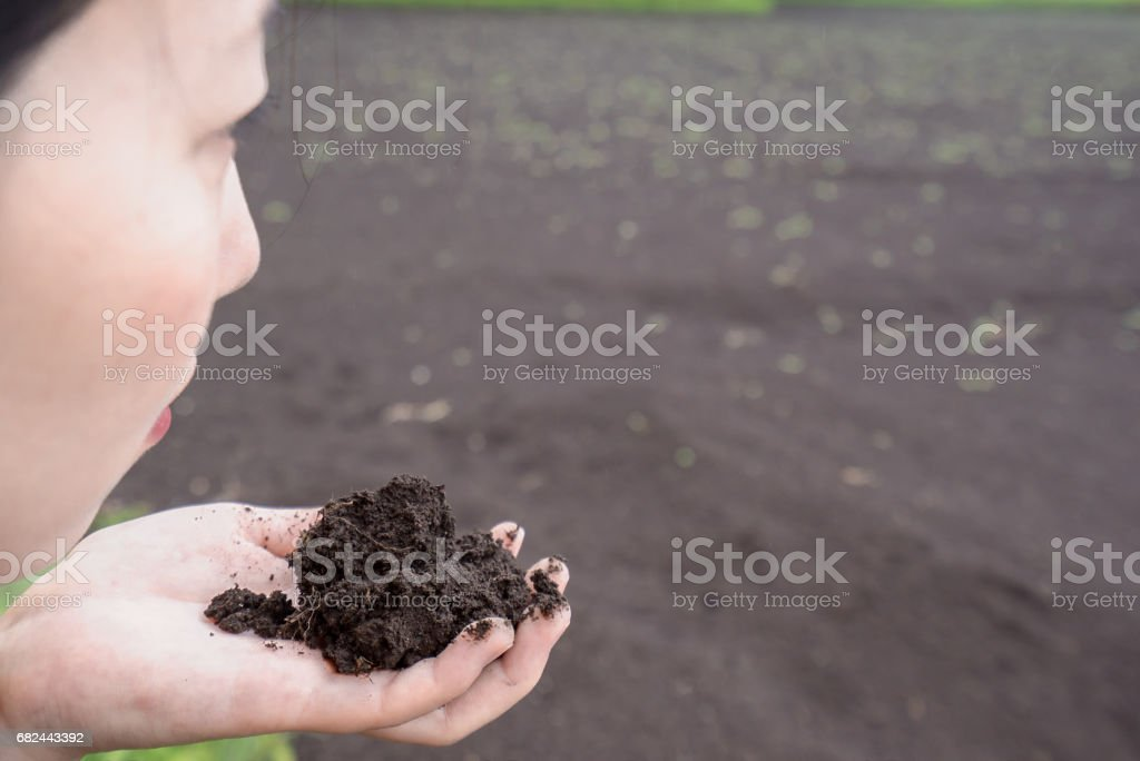 Woman smelling soil royalty-free stock photo