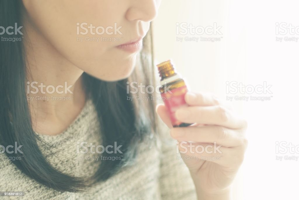 Woman smelling the essential oil Woman smelling the essential oil in Japan Adult Stock Photo
