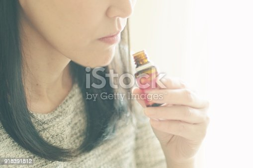 Woman smelling the essential oil in Japan
