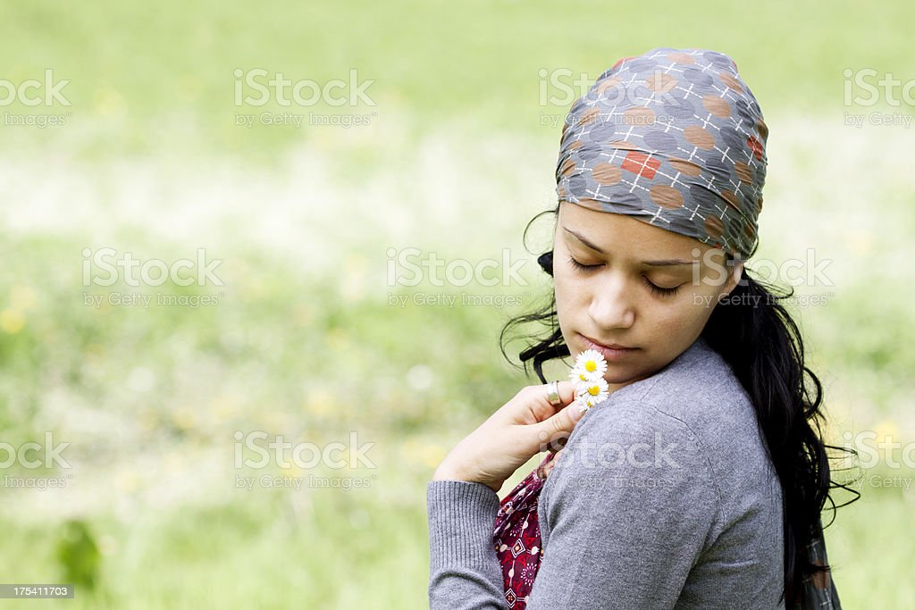 woman smelling wildflower royalty-free stock photo