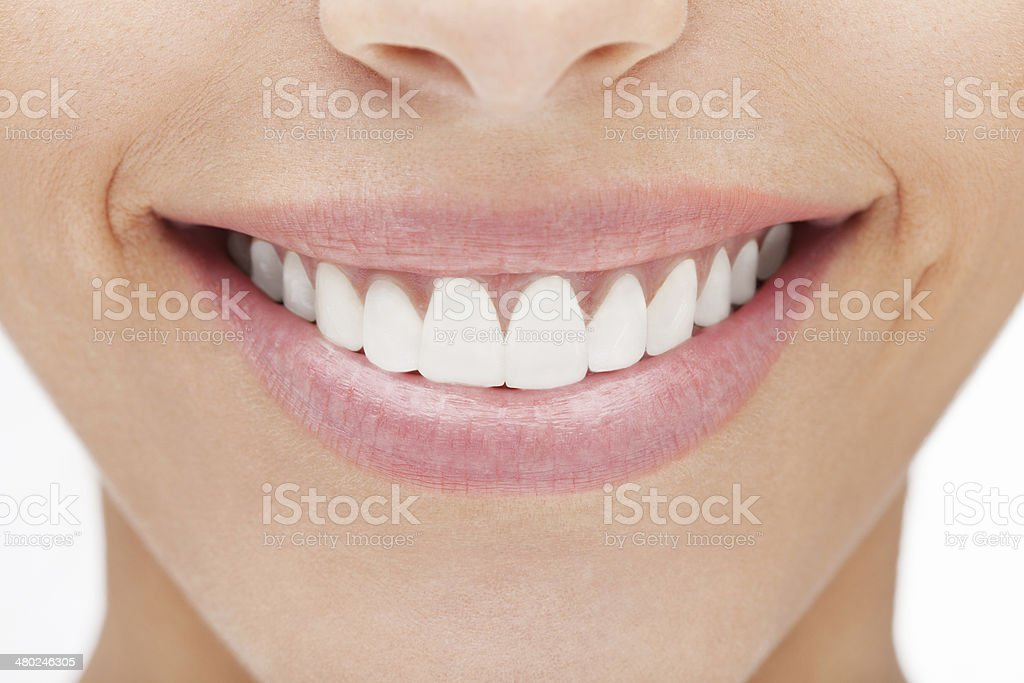 Woman smile Smile of a beautiful young woman . Over white background. Adult Stock Photo