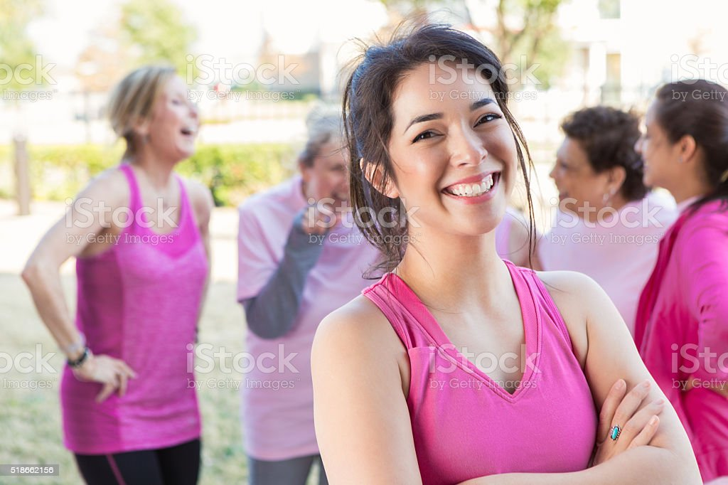Woman smiles at charity race stock photo