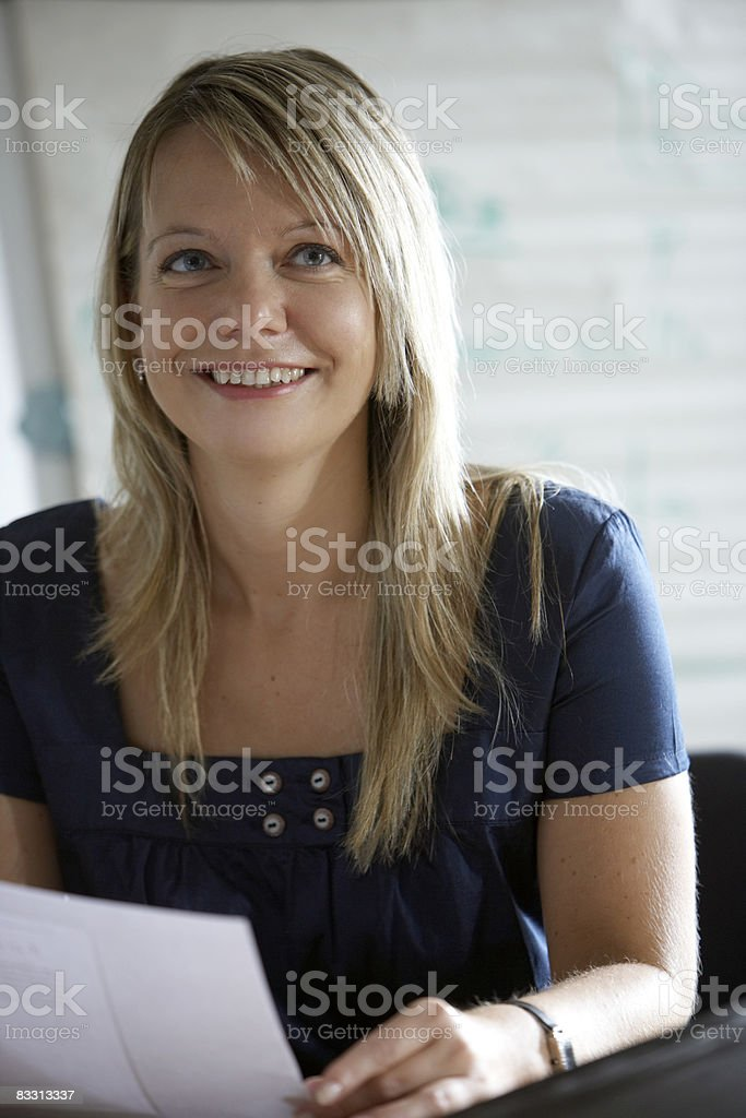 woman smiles in office royaltyfri bildbanksbilder