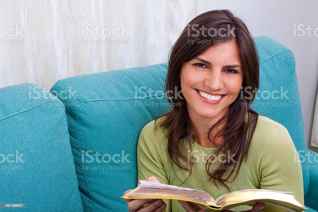 Woman Smiling and Reading royalty-free stock photo