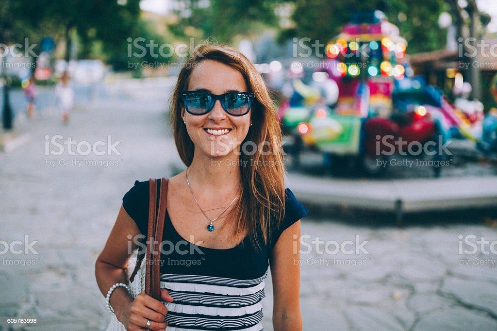 Woman smiling at camera stock photo