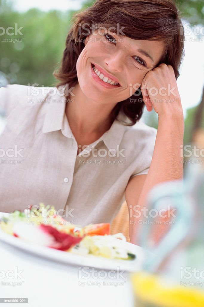 Woman smiling at camera royalty-free stock photo