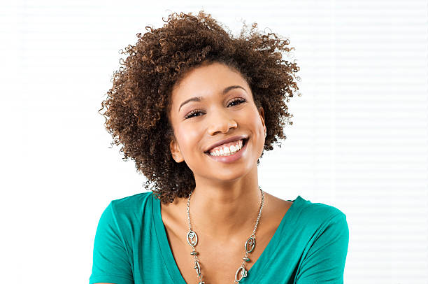Woman Smiling at the camera against a white background stock photo
