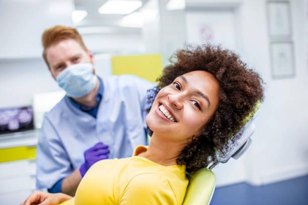 woman smiling during dental checkup - dentist zdjęcia i obrazy z banku zdjęć