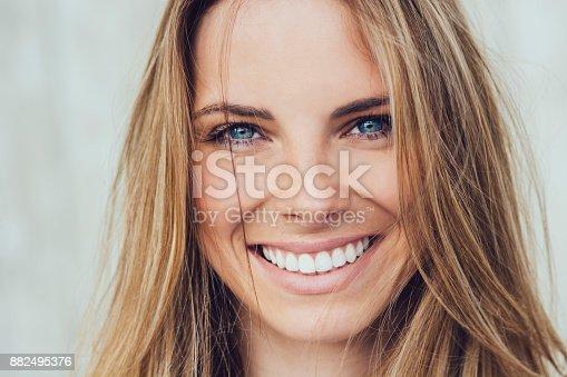 882495390 istock photo Woman smiling 882495376