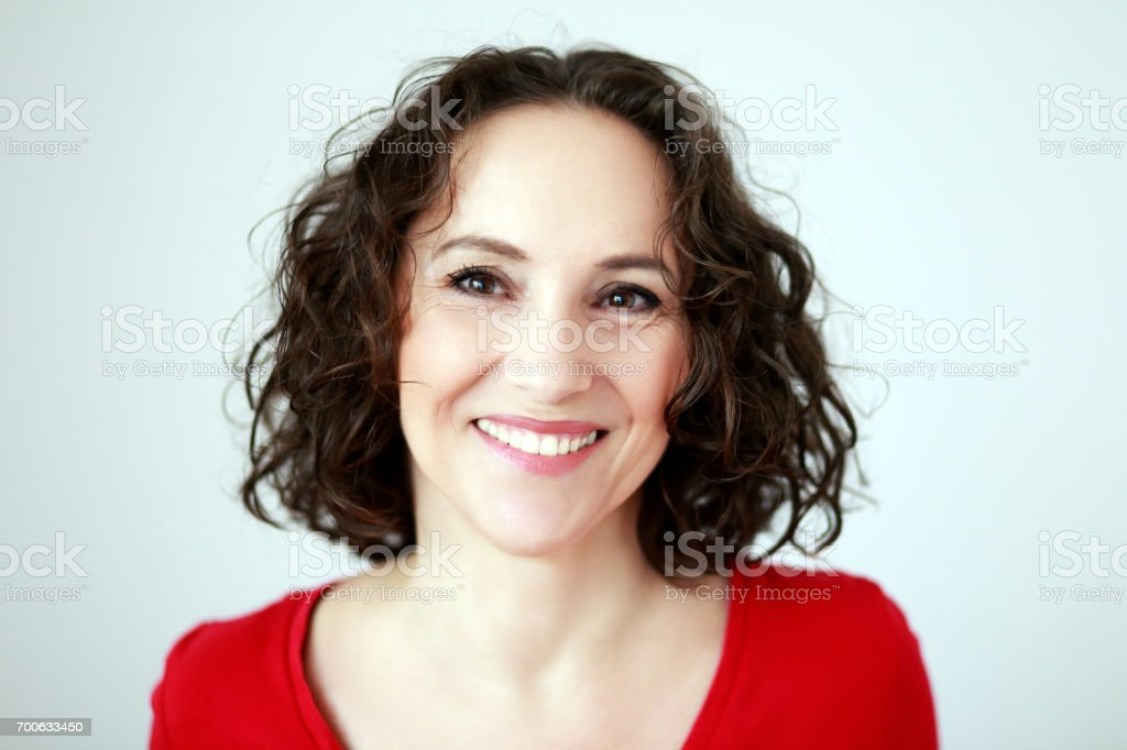 woman smiling to camera stock photo