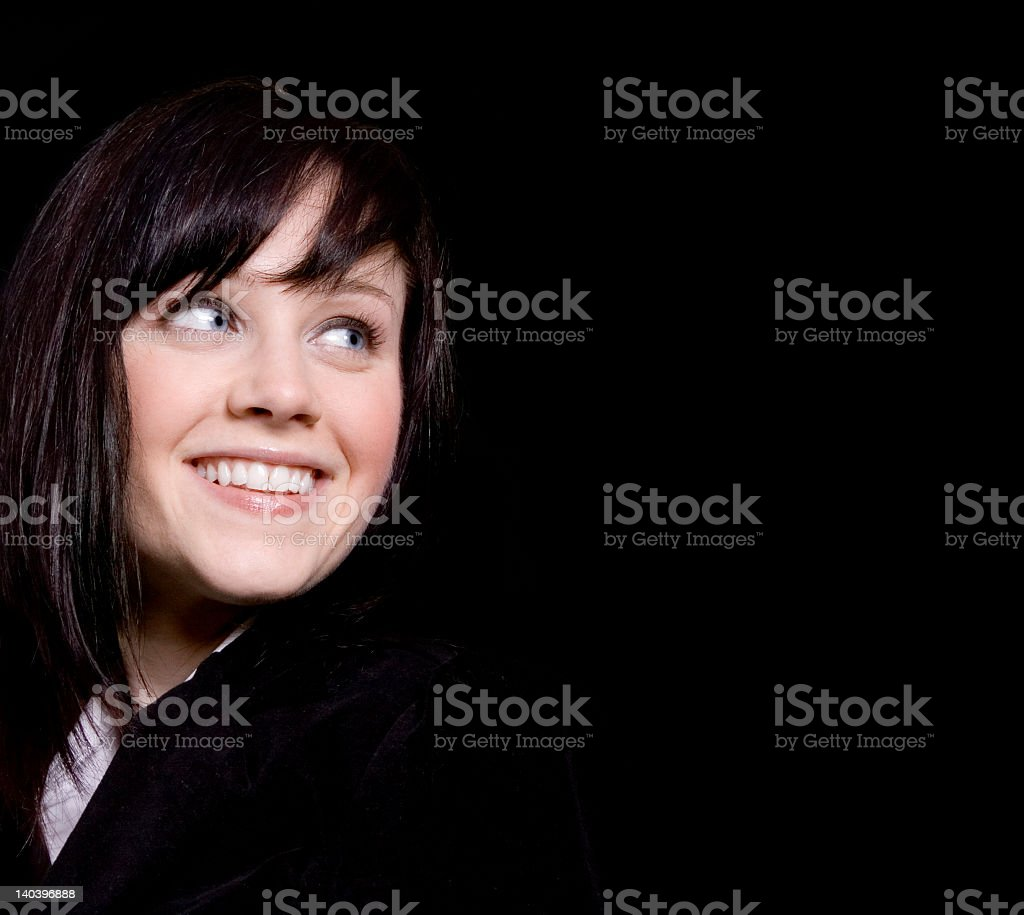 Woman smiling to the right in the dark royalty-free stock photo