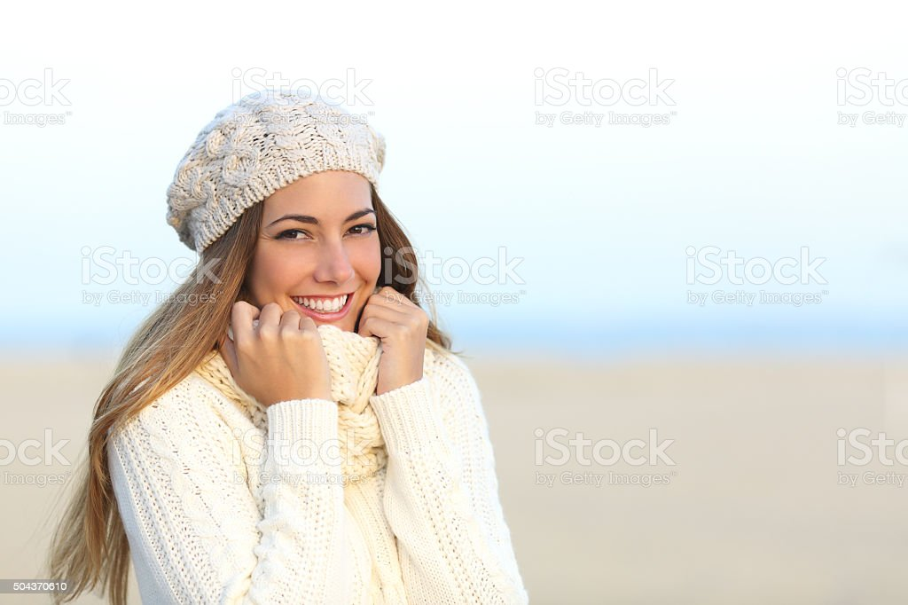 Woman smiling warmly clothed in winter stock photo