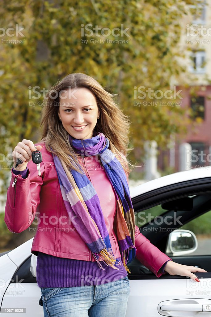 A woman smiling while holding her car keys royalty-free stock photo