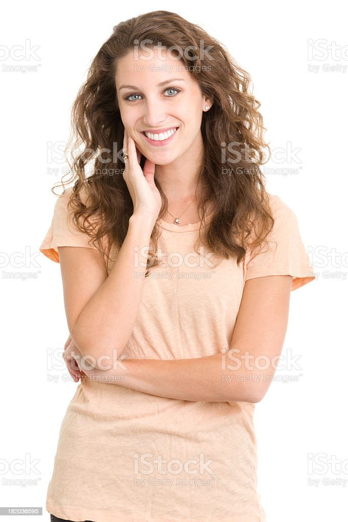 Woman smiling with arm crossed and hand on cheek stock photo
