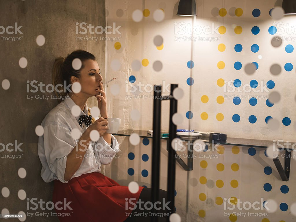 Woman smoking a cigarette on a break. royalty-free stock photo