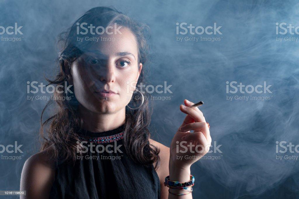 Woman Smoking a Cigarette stock photo