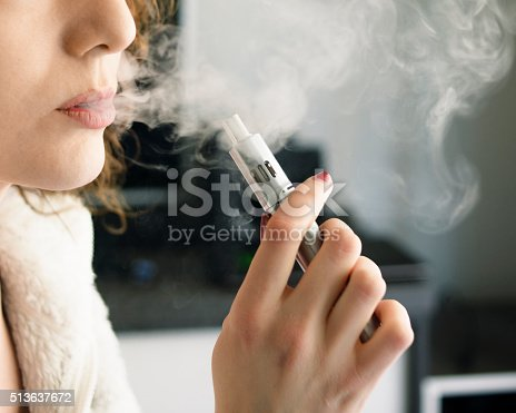 istock Woman Smoking an E-Cigarette 513637672
