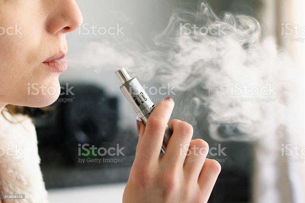 Woman Smoking an E-Cigarette royalty-free stock photo