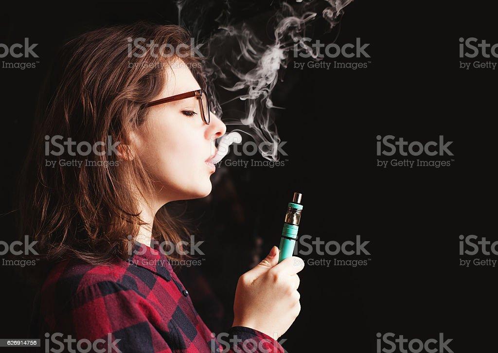 woman smoking electronic cigarette stock photo