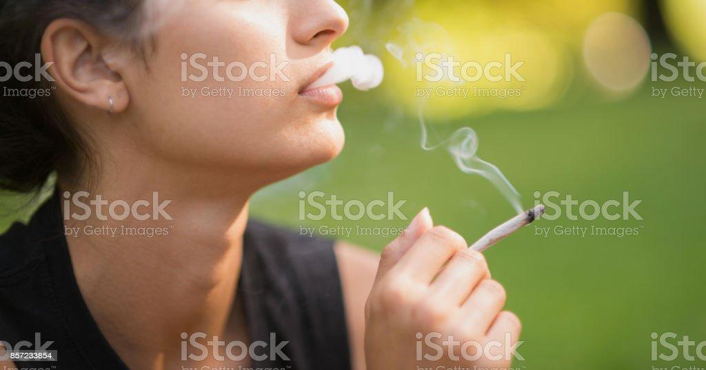 Woman smoking ganja. stock photo