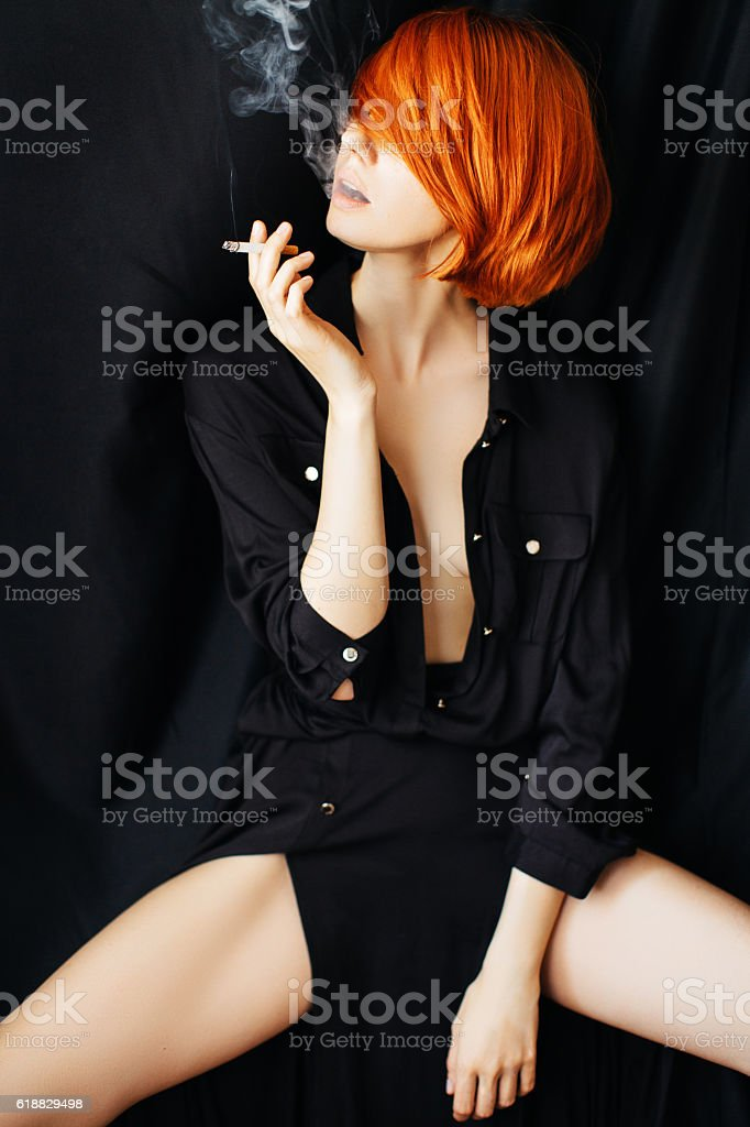 Woman smoking her cigarette stock photo