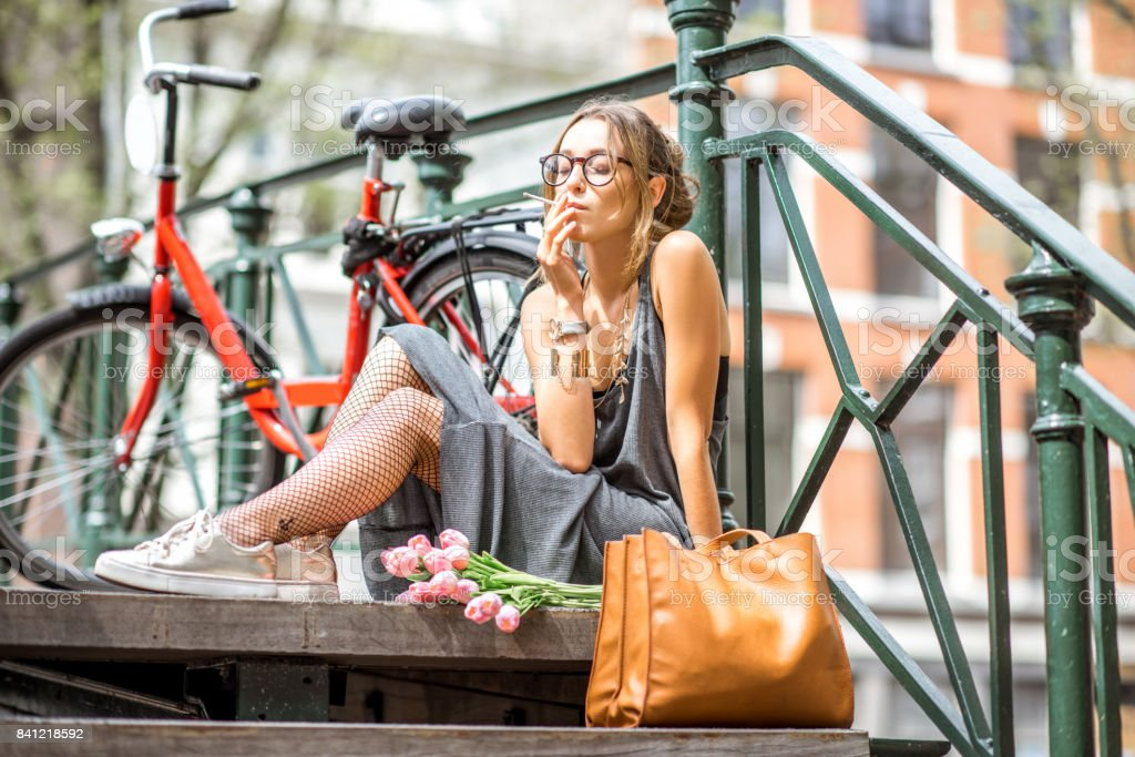 Woman smoking in Amsterdam city stock photo