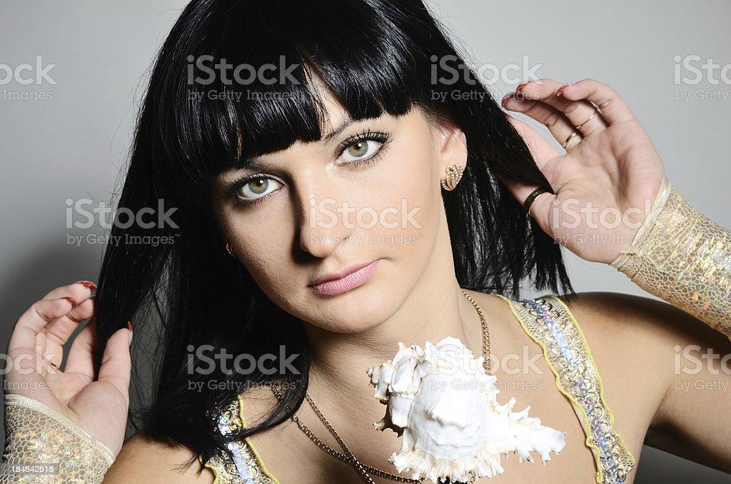 Woman smoothing her long dark hair stock photo
