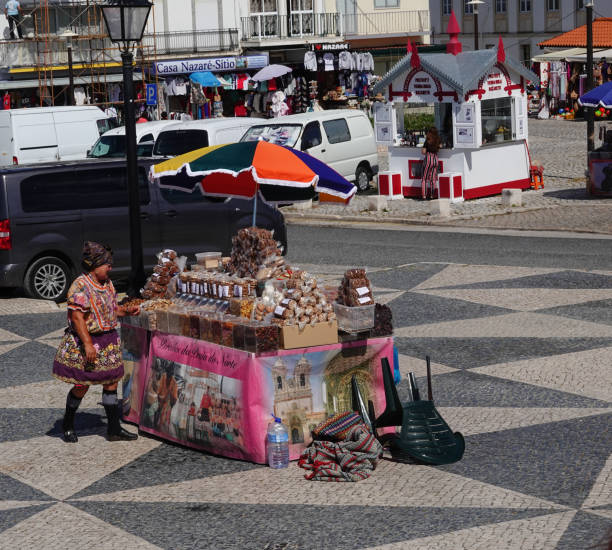 Woman snack vendor wearing traditional petticoats. Nazare, Portugal stock photo