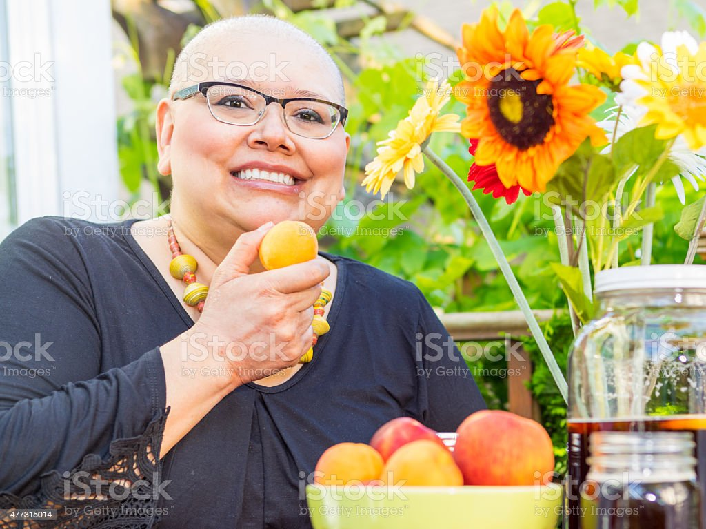 Woman Snacks On Fresh Fruit stock photo