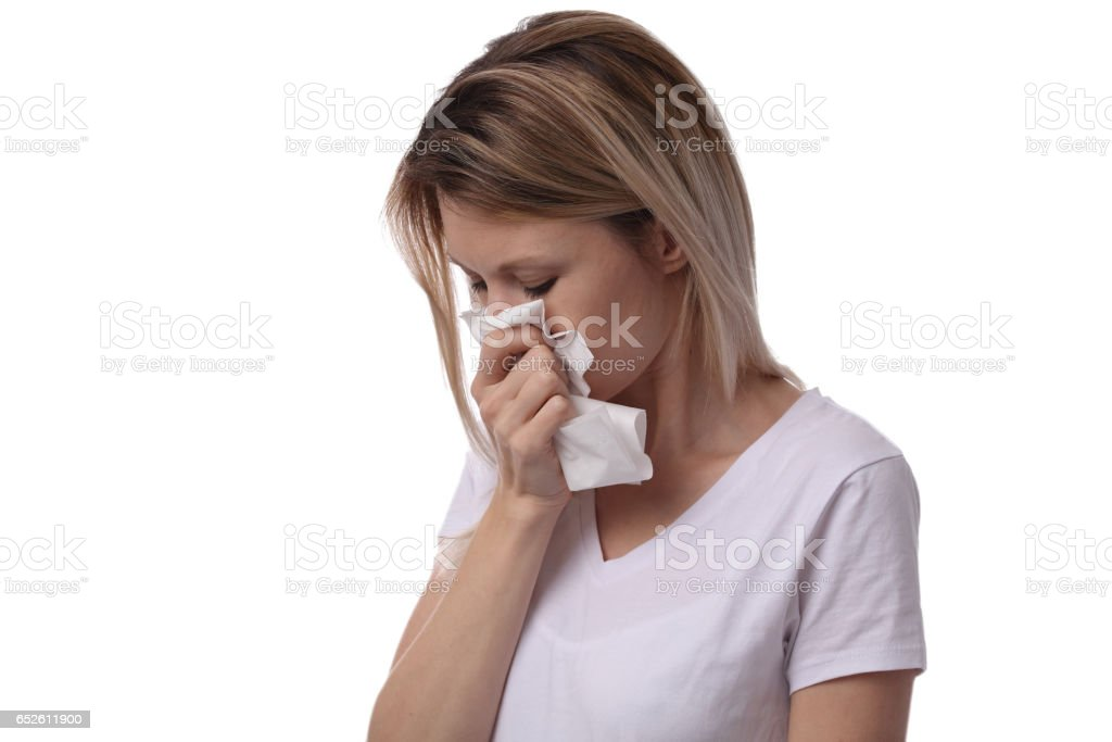 Woman sneezing and holding tissue isolated on white background. Flu symptoms, allergy . Healthcare and medical concept stock photo