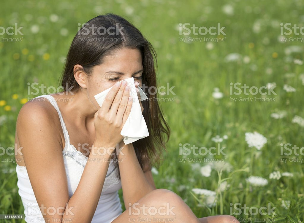 Woman Sneezing, Hayfever, Pollen Allergy stock photo