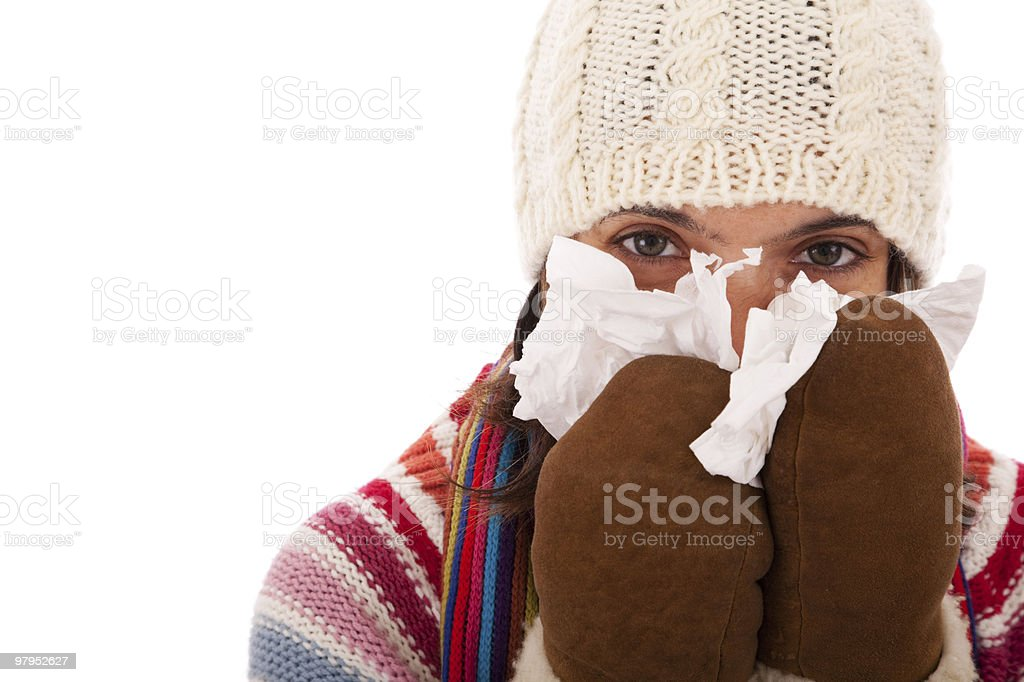 woman sneezing to a tissue royalty-free stock photo