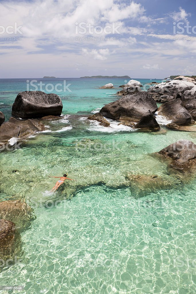 woman snorkeling at The Baths in Virgin Gorda, BVI stock photo
