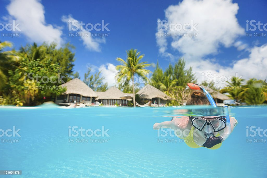 Woman snorkeling stock photo