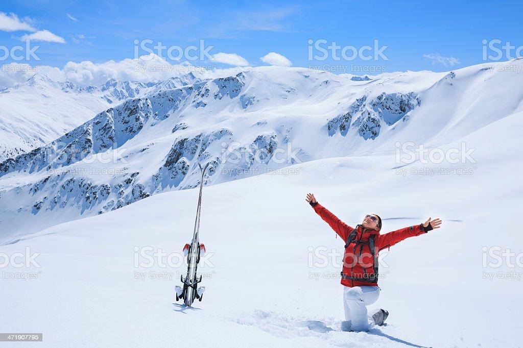 Woman snow skier on ski vacation stock photo