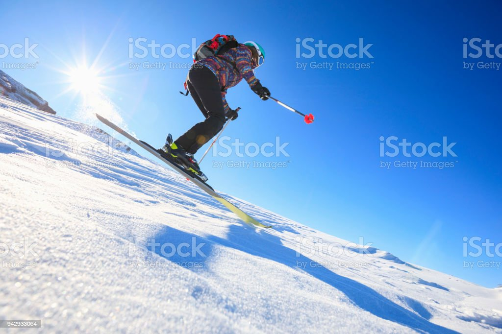 Woman snow skier skiing at sunny ski resort Amateur Winter Sports....
