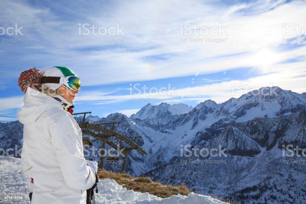 Woman snow skier skiing at sunny ski resort Dolomites in Italy stock photo